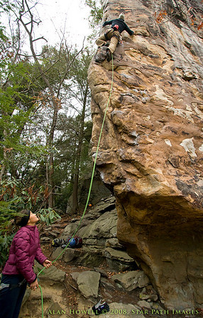 William H. onsighting 'Under the Milky Way', 5.11d. Summersville Lake, WV.