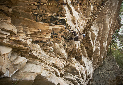 John Johnson hangin' out after the first crux of Apollo Reed, 5.13a. Coliseum Wall at Summersville Lake, WV.