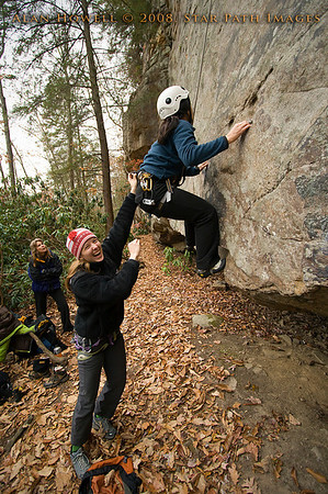 Penn climber, Melissa, 'assisting?' Debbie on the crux of a Long Wall route, Summersville Lake WV.