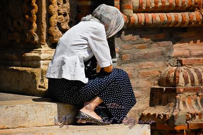 Woman praying, Antim Ivireanu Monastery, Romania.