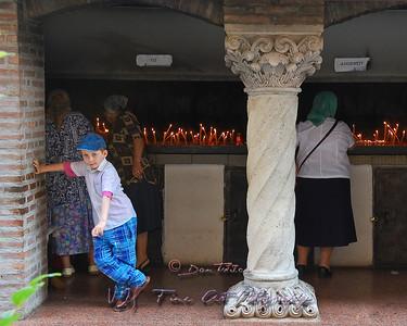Boy waiting from grandmother at Antim Ivireanu Monastery, Romania.