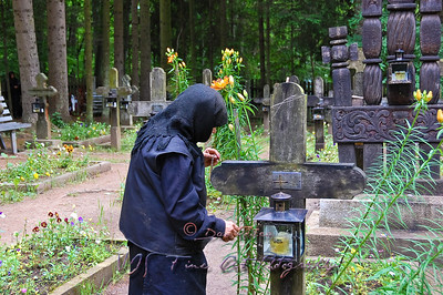 Nun at cemetery, Sihastria Monastery, Romania.