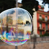 Giant soap bubble on Piazza del Popolo, Rome.