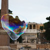 Giant soap bubble on Piazza del Popolo, Rome. Pincio and Villa Borghese in the background.