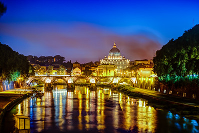 Smoke cloud in front of the Vatican. View along the Tevere in Rome.