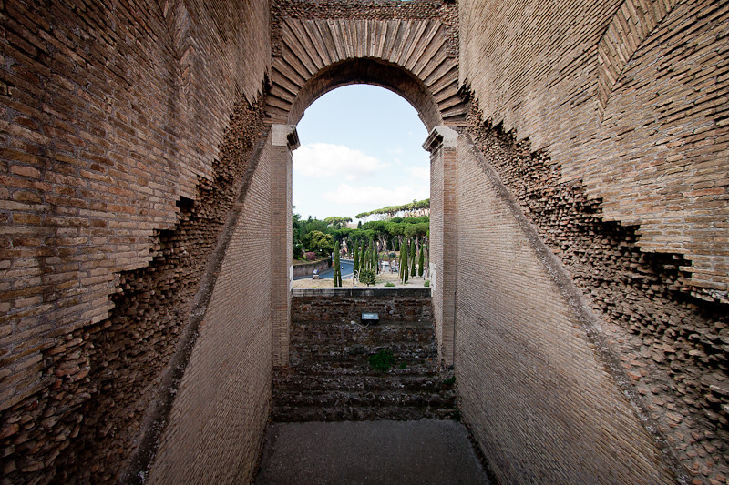 View of the Palatine Hill from inside an arch of the Colosseum