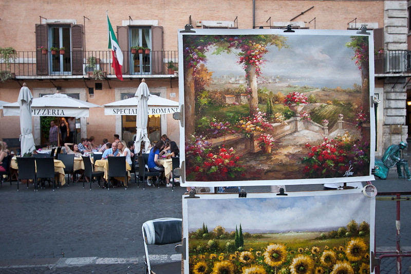 an art vendor and al fresco dinning on the Piazza Navona