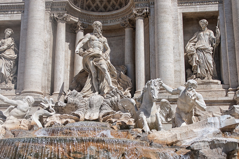 "Neptune at the center of the Trevi Fountain (with a triton and ""restive"" horse at the left and a triton and a ""calm"" horse at the left - representing the two moods of the sea)"
