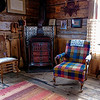 Fireplace adds warmth to this rustic old log cabin