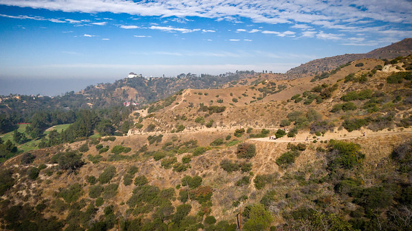 Griffith Park Observatory from the viewpoint off of Vista del Valle Drive.  The Riverside Trail is the one that is going down through most of this shot, but we'll be going on the trail above (just visible over it near the right edge of the frame)