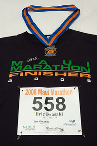 "Those who actually complete the 26.2 mile race not only receive a medal, but a ""finisher"" shirt as well.  On previous races I've run, all participants receive shirts...so this shirt is special!"