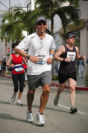 Between Mile 16 and 17, the course turns on to Rodeo Drive.  Shortly after crossing Brighton Way (and without even knowing it at the time) I pass Brian, a former coworker and a much more serious marathoner...what are the chances I would get a photo of that?!?!? (photo by MarathonFoto)