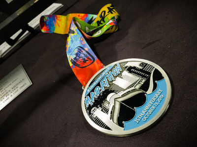 I get a previewing of the finisher's medal from Sunday's race
