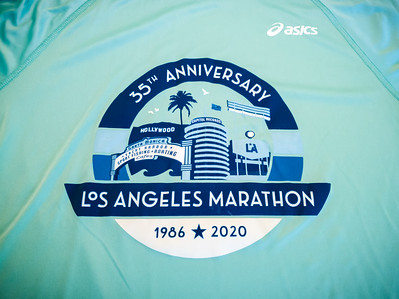 What's the deal with turquiose finisher shirts?  Long Beach's was a similar color, but long-sleeved.