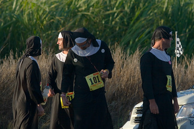 """This team calls itself """"Team Offensive"""".  I just assumed they were """"Nuns on the Run"""".  Either way, I cannot believe anyone in Hawaii would run wearing black"""