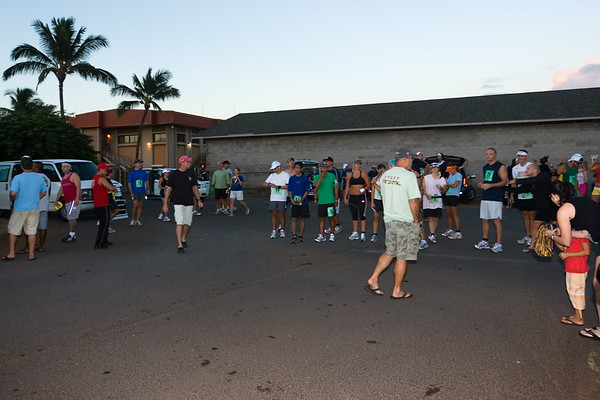I hand my camera to Mitch and then line up at the starting line.  One last check that my Garmin Forerunner 205 GPS has synchronized with the satellites and I am ready to run.  (Photo by Mitch)