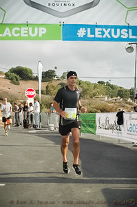John finishes in 01:48:03, 4th in his age group