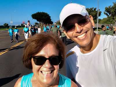 After I finish, I meet up with Jim and Ryan.  We walk back on to the course to find the walkers, so I can get a selfie with my mom...