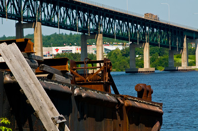An old rusting barge on the shore of the Miramichi River