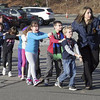 Police lead children away from Sandy Hook Elementary