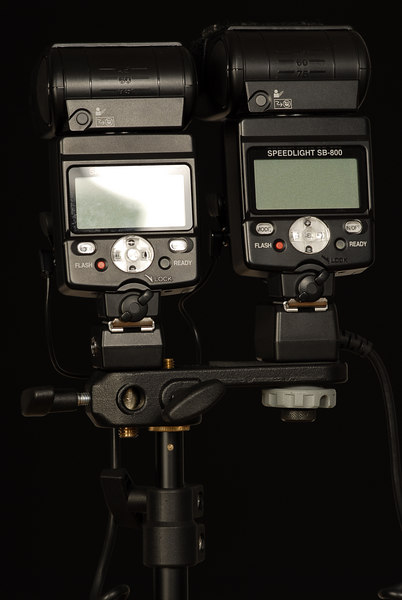 Twin pack SB-800 for more power and recycle time.<br /> First SB-800 on right is the master with a SC-29 cable attached to the camera, the second one may be fired automatically via CLS or in Manual SU-4 mode via a single PC-PC cable as illustrated above.