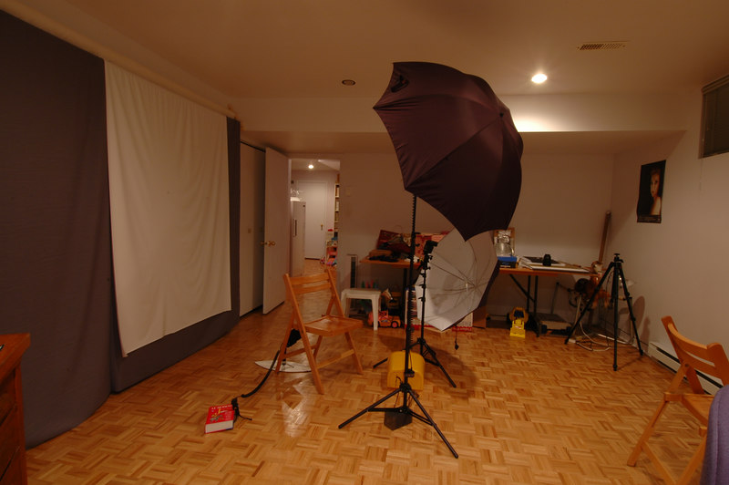 "DSC_3362  My first home made studio.  Wal-Mart  provide the backdrop muslin but only 60"" wide.  Two Opus 7' stand with 42"" Photoflex Umbrellas (shoot thru and convertible) for SB-600 (Fill-in) and SB-800  main light.  SB-27 with Optex Eye-slave for the background lightning."