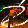 Firedancer in Ko Lanta, spinning a pattern that nearly resembles the tattoo on his back.
