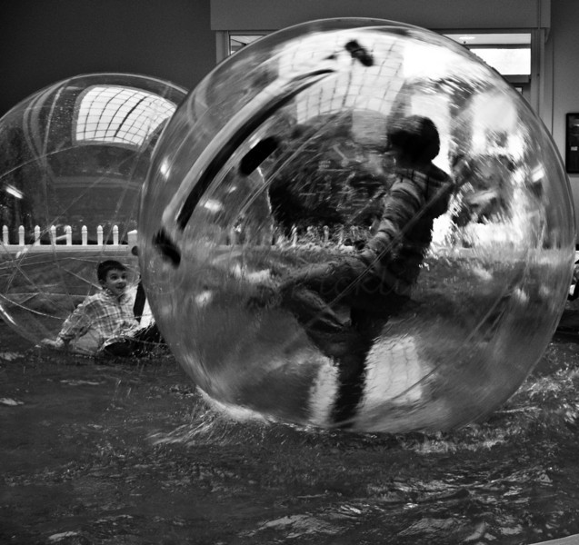 Kid in a Bubble on Water at the mall.