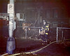 Rescue 11/28/86<br /> Here the same little boy in the 2nd photo in this album standing next to his dad, carrying a 68 yr. old woman from a fire building on N. Sheridan Rd. <br /> Photo with permission ©Jim Regen, 1986, 2006.
