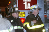 "Battalion 14 Chief Jerry McKee (r), with brother Jack (l) at the dollar store fire  11/12/02.<br /> brick Badly injured, he was not healed after a year and the CFD retired him. He went to work as an electrician for NASA at the Kennedy Space Center the next 20 years. Motivated by 9/11 he attempted to get back on the CFD. Fifty-six years old, he passed  test and was assigned to TL5. Asked why he decided to come back. He answered; ""Because I felt like I owed something to the job""."