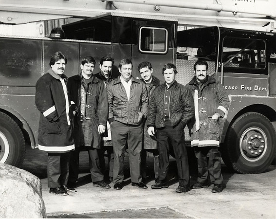 "SS1 1979<br /> Snorkel Squad 1 in 1979, a precursor to today's Squads. (l-r) Tom Murphy. Bob Hoff, Jerry McKee, Bill O'Boyle, Steve Bybee, Tom Donnellan, Tony Thomas. These men, and the others of this era, set a high standard for the Squads of Today. Tom Murphy became a Lieutenant, Bob Hoff, an author and currently CHICAGO FIRE COMMISSIONER (see also this exhibit, ""Squad 1, First Shift""), Jerry McKee, now retired as Battalion 14 Chief (see also ""Fire"" exhibition directly below ""The Squad"" exhibit. and within it, ""A Family Tradation'), Bill O'Boyle, now retired was Captain of Squad 1, Steve Bybee is Chief of Support Services, Tom Donnellan, was Assistant Deputy Fire Commissioner before his retirement in 2005. <br /> <br /> PLEASE HAVE A LOOK AT THE OTHER PHOTOS IN THES ALBUM. THEY ARE OF THESE MEN, ONE AS A KID WITH HIS POP, THREE IN THE PRESENT."