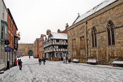 Through Exchequergate and into Castle Square. More footprints from the faithful inside the Cathedral, and a small group of photographers already gathering by the Castle.
