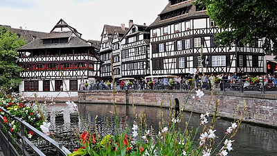 Strasbourg, France.  This town has changed hand between Germans and French numerous times. This side of the town has unmistakably Germanic heritage affixed to it.