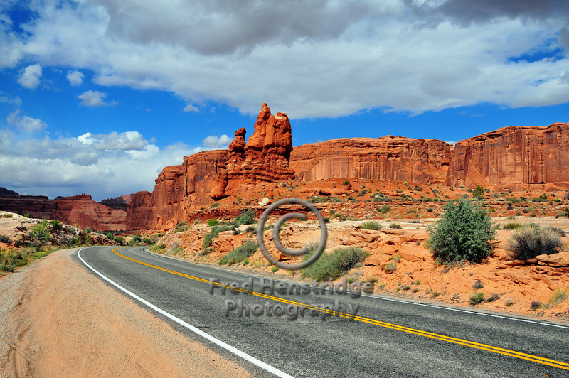 Looking southerly along the Arches Park Entrance Road with the Three Gossips in the foreground