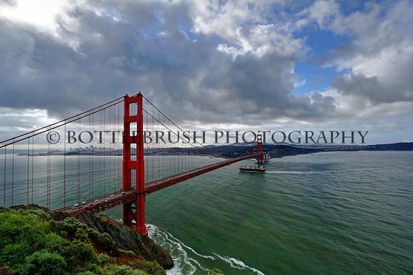 Ship passing under the Golden Gate Bridge into the San Francisco Bay.