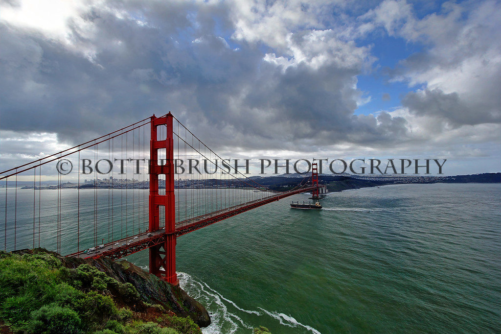 Ship passing under the Golden Gate Bridge into the San Francisco Bay.
