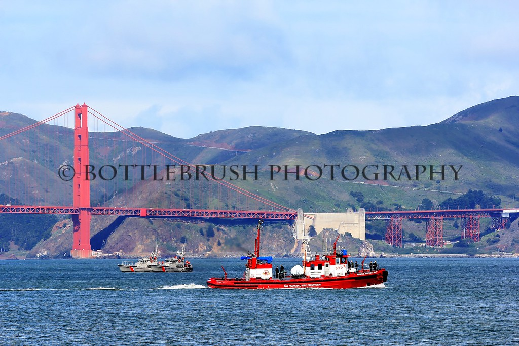 "San Francisco Fire Department fireboat called the ""Phoenix"" in the bay with the Coast Guard."