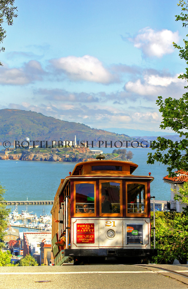 San Francisco's Cable Car on Hyde Street with Alcatraz in the background.