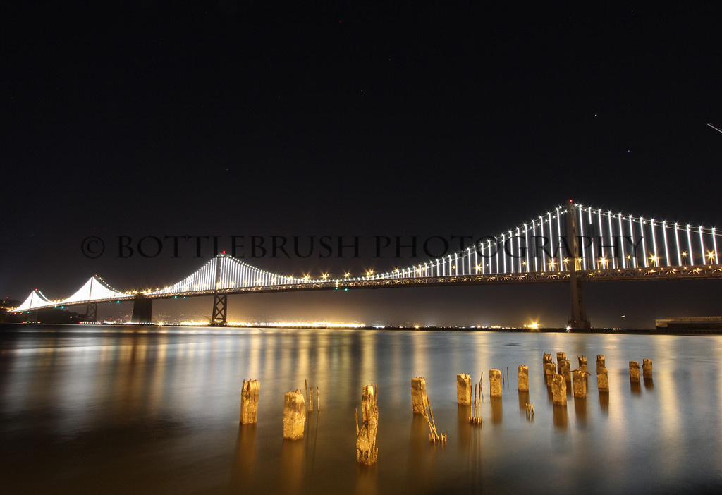 The new Oakland Bay Bridge with Oakland city lights.