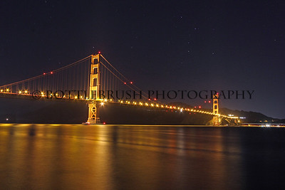 San Francisco's Golden Gate Bridge and the bay waters in the evening.