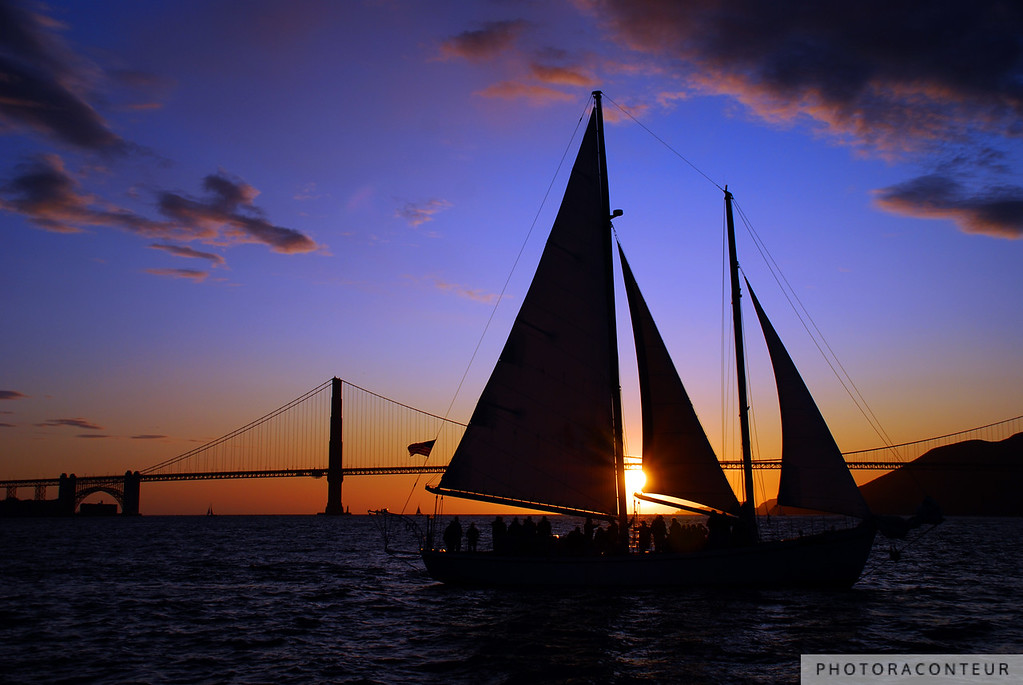"""""""Schooner Sunset on the Bay"""" ~ Sightseers aboard a classic schooner watch the sunset beyond the Golden Gate Bridge as beautiful shades of violet and peach fill the sky."""