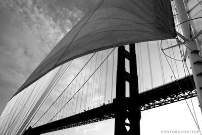 """Through the Sails III"" ~ A silhouette of the Golden Gate Bridge's south tower appears under a windblown sail."