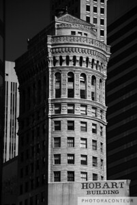 """The Hobart Building"" ~ Designed by architect Willis Polk, the Hobart Building is a popular historic landmark in San Francisco.  The exterior is a prime example of neoclassical architecture and is composed of sculpted terra cotta.  The Hobart Building is surrounded by modern skyscrapers, providing one example of many where modern buildings blend harmoniously into this cityscape filled with historic architecture."