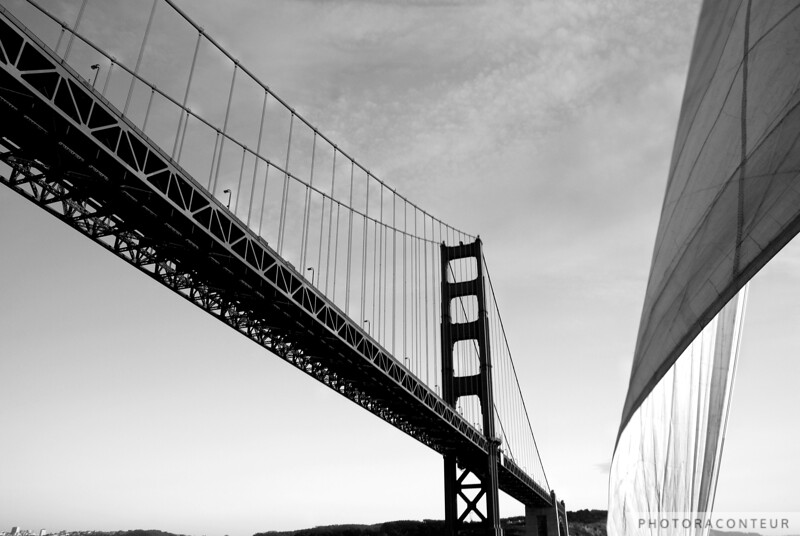 """Through the Sails IV"" ~ The south end of the graceful Golden Gate Bridge flanked by a windblown sail."