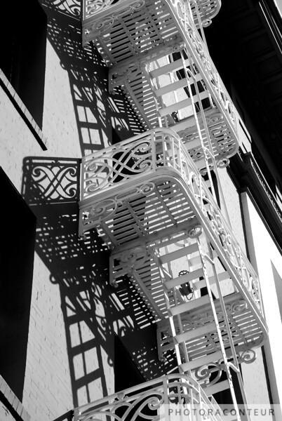 """Escape into the Shadows"" ~ Shadows of a fire escape decorate the façade of a hotel in the Union Square area of San Francisco."