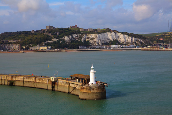 Dover lighthouse and in the distance, is the Dover Castle.