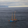A sail boat in the channel near Torshavn.
