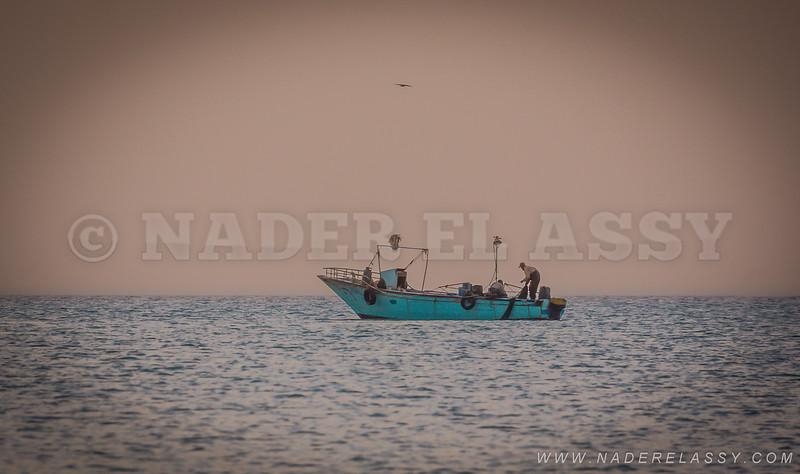 The fishing boat before sunrise