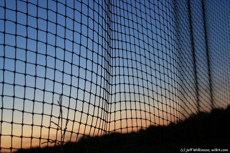 "#2814 sunset through a net at a mini-golf course (another photo from this series is for sale on istockphoto as #<a href=""http://www.istockphoto.com/file_closeup.php?id=4550797?refnum=jwilkinson"">4550797</a>)"
