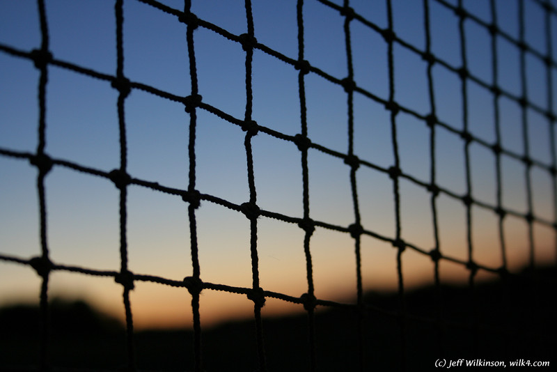 "#2810 sunset through a net at a mini-golf course (another photo from this series is for sale on istockphoto as #<a href=""http://www.istockphoto.com/file_closeup.php?id=4550797?refnum=jwilkinson"">4550797</a>)"